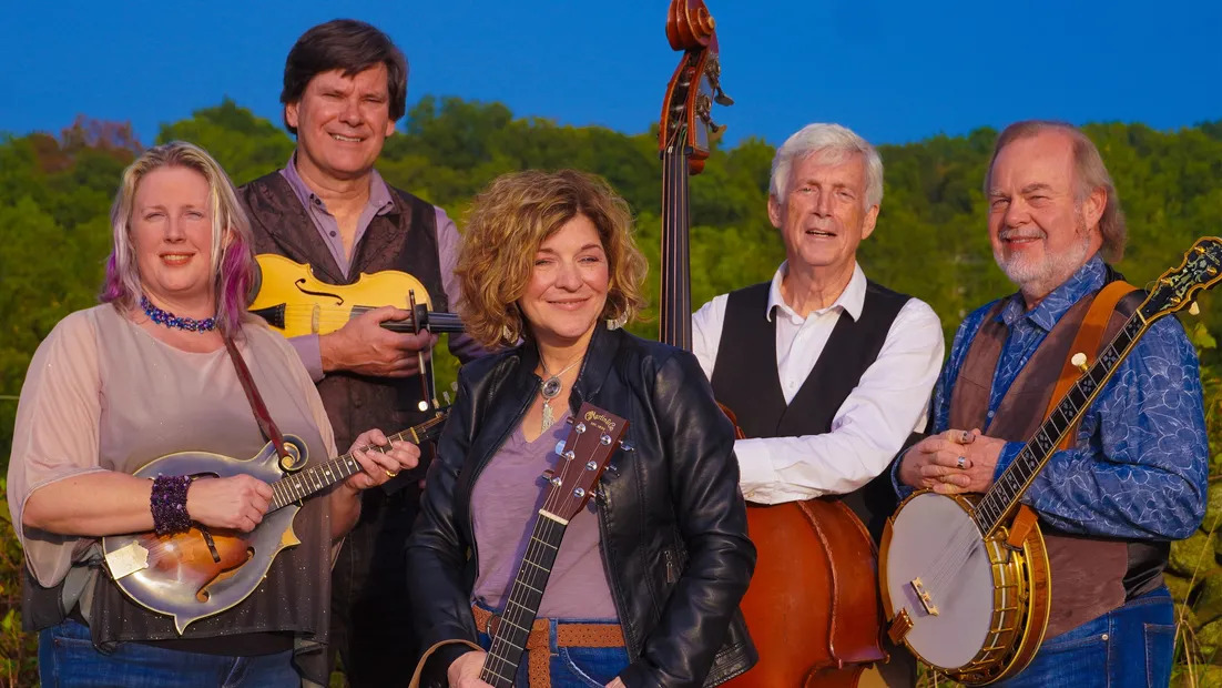 "`<img alt=""Picture of Valerie Smith and Liberty Pike, 2 Woman and 3 men with a variety of instruments""`>"